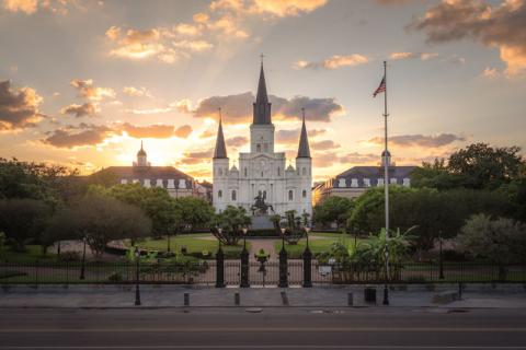 St. Louis Cathedral in New Orleans with clouds and sun behind