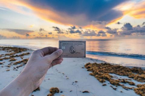 American Express Card on a beach at sunset.