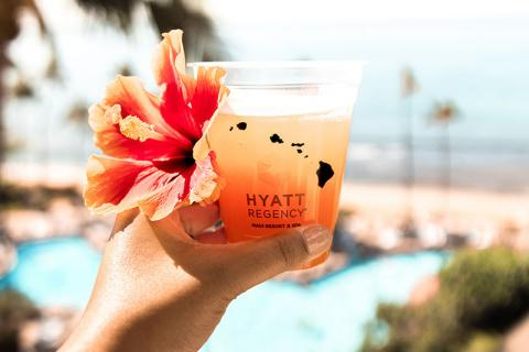 Hyatt Hotels, drink with flower beside the pool
