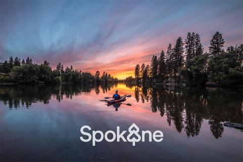 Spokane, Boat on the water with trees and the sunset